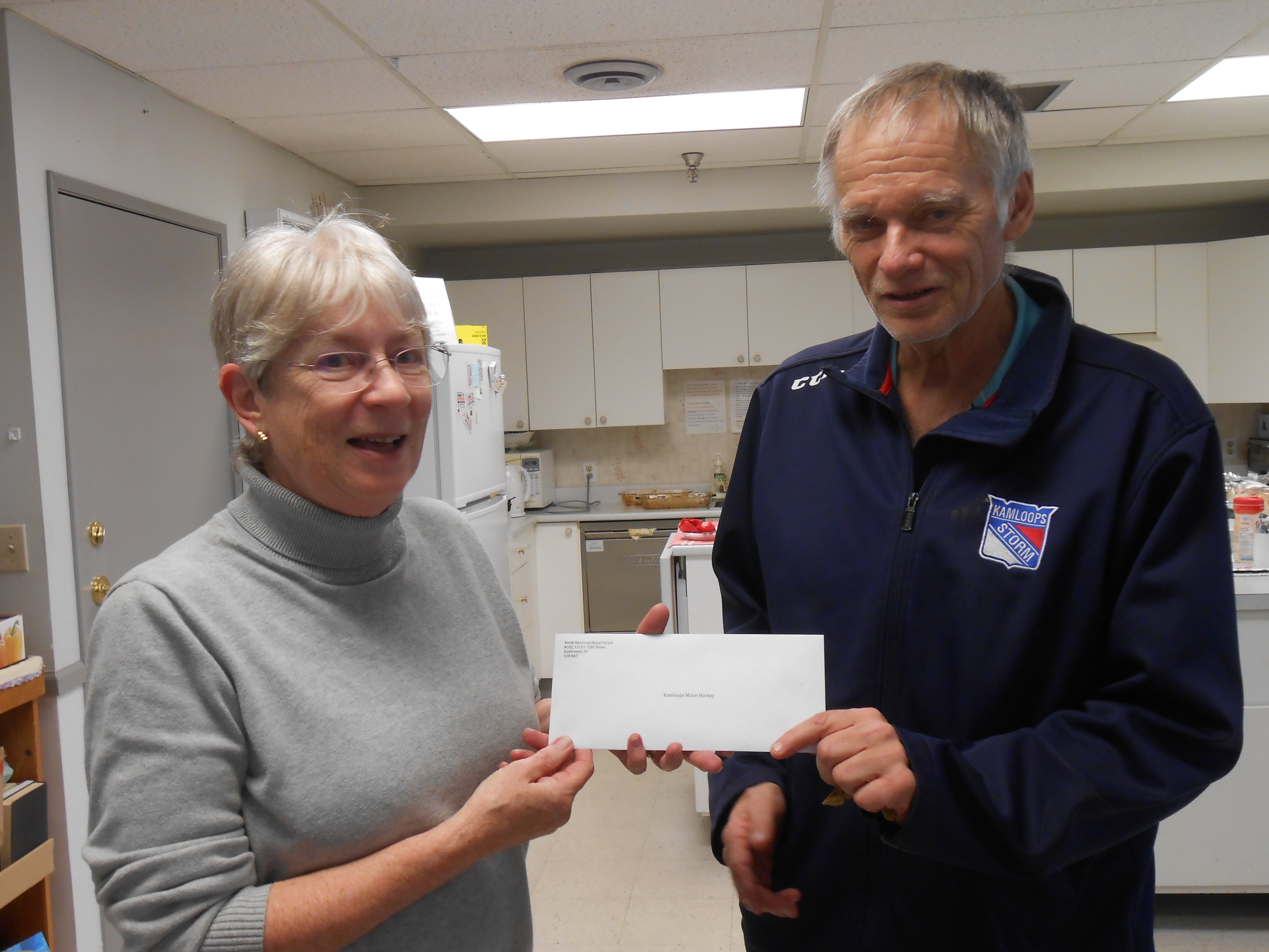 Merrilyn Pennanen presenting a cheque to KMHA on behalf of the North Kamloops Royal Purple