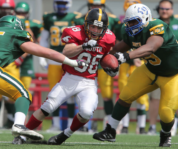 Duane Neustaeder from Olds eludes North tacklers